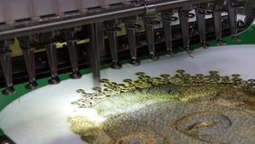 Embroidery machine is used to create patterns on textiles stock video