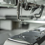 Embroidery machines image close up. At emboriding area parts as follows : needle, presser foot, laser guide, automatic threading, white thread Royalty Free Stock Images