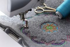 embroidery of mandala on felt with embroidery machine stock photography