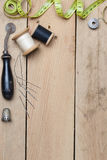 Embroidery and needlework tools on wood background Stock Photo
