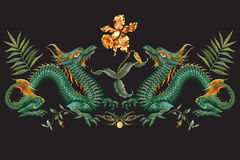 Embroidery oriental floral pattern with green dragons and tiger vector illustration