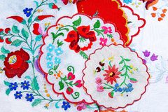Embroidery. Patchwork handwork embroidery closeup texture pattern studio photo background. Floral hungarian flower Embroidery stock photos