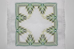 Embroidery. With a pattern of green colors Royalty Free Stock Photos