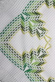 Embroidery. With a pattern of green colors Stock Photography