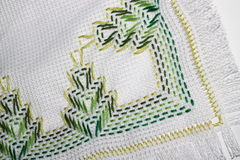 Embroidery. With a pattern of green colors Stock Photos