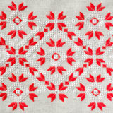 Embroidery pattern by red and white cotton threads for background or cover. Craft embroidery. Royalty Free Stock Photo
