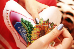 Embroidery process on fabric beads hands stock image
