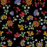 Embroidery repeat pattern with meadow flowers. Vector seamless floral patch for clothing design royalty free illustration