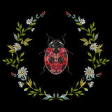 Embroidery round floral pattern with chamomiles and ladybug. Vector traditional folk fashion ornament with flowers, leaves and beetle on black background stock illustration