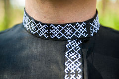 Embroidery the Russian ornament on a collar. Man in russian folk shirt Royalty Free Stock Image