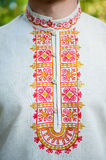 Embroidery the Russian ornament on a collar. Man in russian folk shirt Stock Image