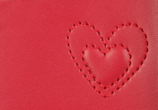 Embroidery in shape of two hearts on pink leather Stock Image