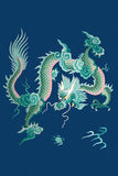 Embroidery in silk. Chinese dragon Stock Photos