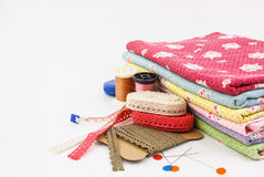 Embroidery. A stack of cloth and embroidery tool Stock Photos