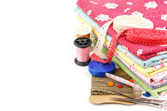 Embroidery. A stack of cloth and embroidery tool Royalty Free Stock Photography