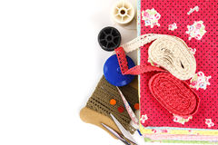 Embroidery. A stack of cloth and embroidery tool Royalty Free Stock Images