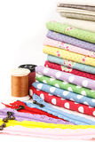 Embroidery. A stack of cloth and embroidery tool Stock Photography