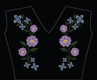 Embroidery stitches with primarose primula vulgaris and lilac fl Royalty Free Stock Photos