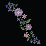 Embroidery stitches with primarose primula vulgaris and lilac fl Stock Image