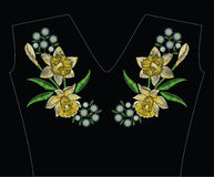 Embroidery stitches with yellow narcissus daffodil, chamomile an Stock Photo