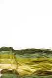 Embroidery thread. Different green colors of embroidery threads with copy space Royalty Free Stock Photo