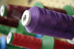Embroidery Thread Bobbin. Embroidery machine for caps, t-shirts, etc Royalty Free Stock Image