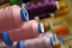 Embroidery Thread Bobbin. Embroidery machine for caps, t-shirts, etc Stock Image