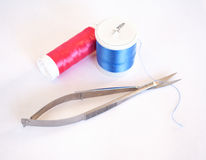 Embroidery thread and scissors isolated on white Royalty Free Stock Images