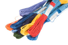 Embroidery threads. Different color embroidery threads isolated on white Royalty Free Stock Images