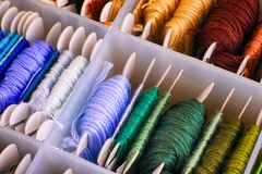 Embroidery threads sorting in box. Close-up royalty free stock photos