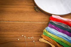 Embroidery tool on wooden background. Stock Photography
