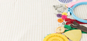 Embroidery tools on fabric as background Royalty Free Stock Photography