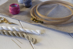 Embroidery tools with hoop and threads Royalty Free Stock Photography