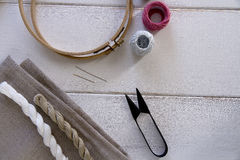 Embroidery tools with hoop and threads Stock Photo
