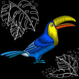Embroidery toucan fabric design. Embroidery toucan artwork for clothing, patches and stickers. Tropical bird and monstera leaves. Decorative fancywork elements Royalty Free Stock Photo