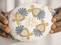 Embroidery on a traditional celebration hat - sub-saharian Africa Stock Images
