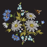 Embroidery trend floral pattern with chamomiles, cornflowers and bee. Vector embroidered folk flowers bouquet on black background for clothing design royalty free illustration