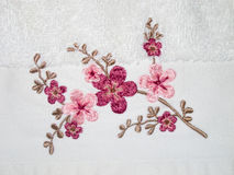 Embroidery on white towel Stock Photography