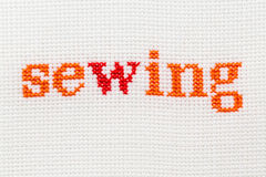 Embroidery word Caption sewing. Stock Photo