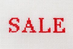 Embroidery word Sale cross stitch Royalty Free Stock Photos