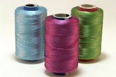 Embroidery yarn bobbins stock image