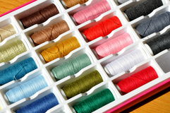 Embroidery yarn bobbins Stock Photos