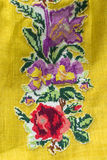 Embroidery on yellow cloth Royalty Free Stock Photos