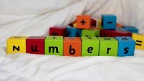 Embroma números de bloques Imágenes de archivo libres de regalías
