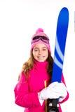 Embrome el esquí de la muchacha con las gafas del equipo de la nieve y el sombrero del invierno Fotografía de archivo