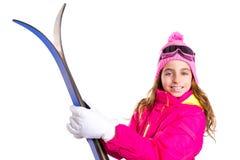 Embrome el esquí de la muchacha con las gafas del equipo de la nieve y el sombrero del invierno Imagen de archivo