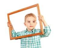 Embrome el marco de madera del control en el fondo blanco Foto de archivo