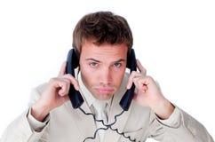 Embrouillement contrarié d'homme d'affaires vers le haut en fils de téléphone Photos libres de droits