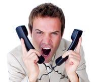 Embrouillement furieux d'homme d'affaires vers le haut en fils de téléphone Image stock