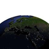 EMEA gebied bij nacht op model van Aarde met in reliëf gemaakt land Stock Foto